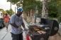 Jiggs Shaheed on the grill at Open Mic at Ile Ife Park, photo by Lori Waselchuk