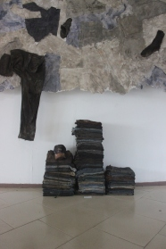 Praises Benhene, Untitled II #from the Broken Archive, plaster of paris; decommissioned work gears (trousers, shirts, dresses, shoes), installation, dimensions variable, photo courtesy Patrick Nii Okanta Ankrah
