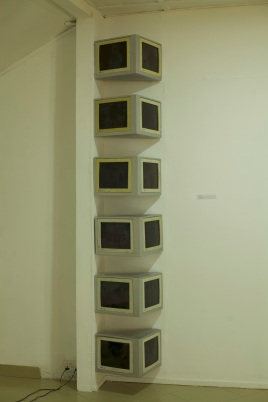 Mawuenya Amudzi, Imagination…, 2018, Disused Cathode Ray Tube (CRT), computer monitors, auto-based paint, LED light, wood, plywood, 120in x 22in x 12 in, installation view, photo by Elolo Bosokah