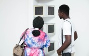 Mawuenya Amudzi, Imagination…, 2018, Disused Cathode Ray Tube (CRT), computer monitors, auto-based paint, LED light, wood, plywood, 120in x 22in x 12 in, installation view, photo by Leon Photos