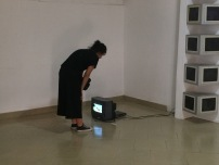 María Leguízamo, FLY, 2016, Duration: 5:19 Minutes, Dimensions: 1920 x 1080, 32' TV monitor with recording of YouTube compilation of explosions in 2016, dead fly, honey, installation view, photo by Elolo Bosokah
